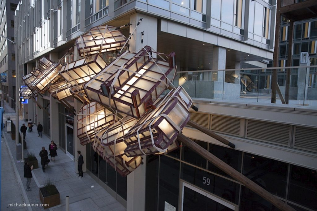Caruso's Dream is made up of glass pianos suspended above the street