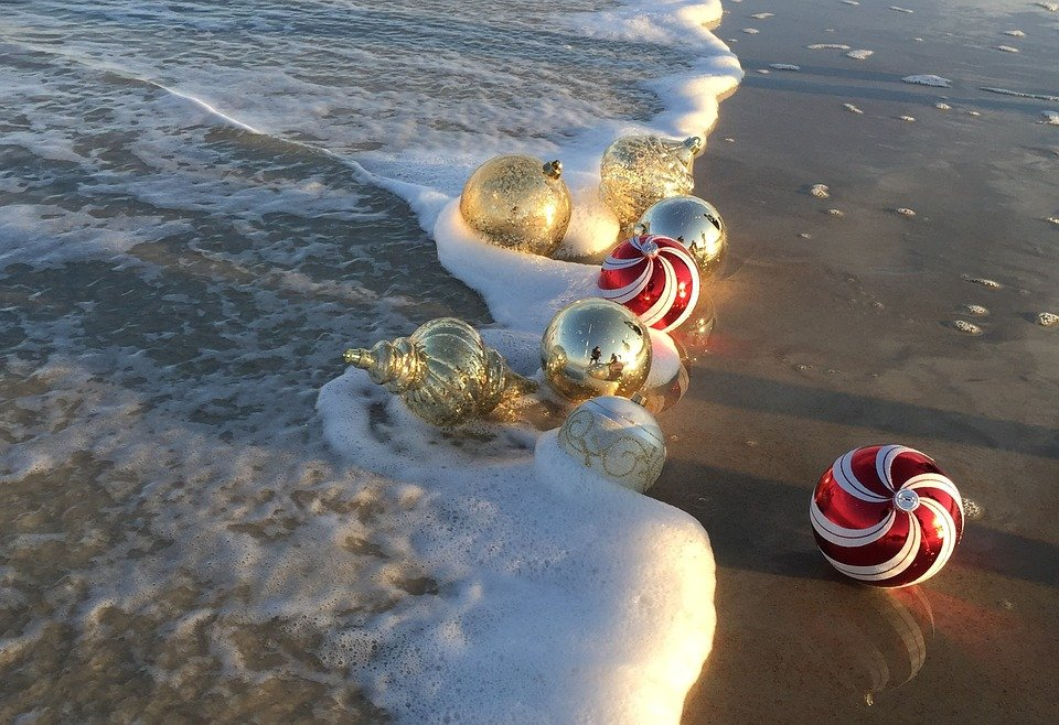 Christmas baubles on the seashore
