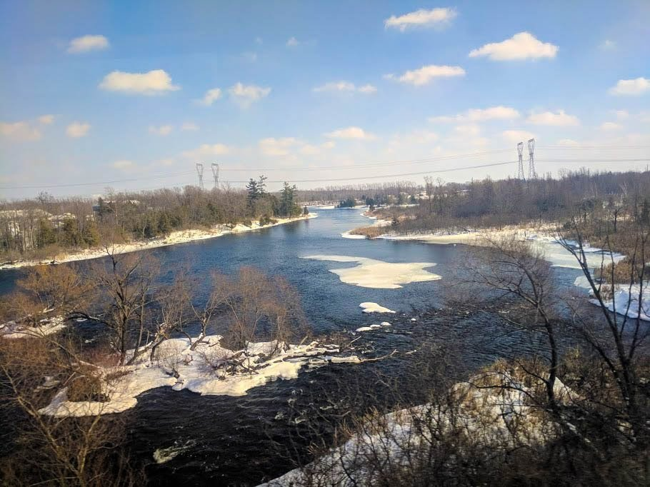 Explore Canada by train to see this beautiful river during winter