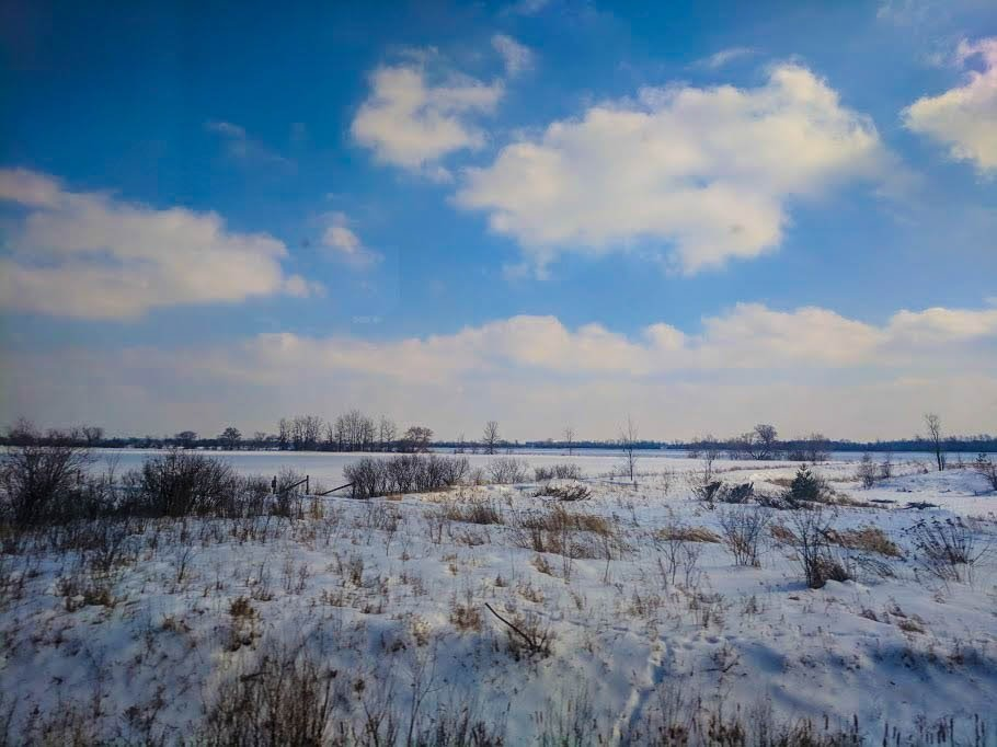 Snowy plains through the VIA Rail window