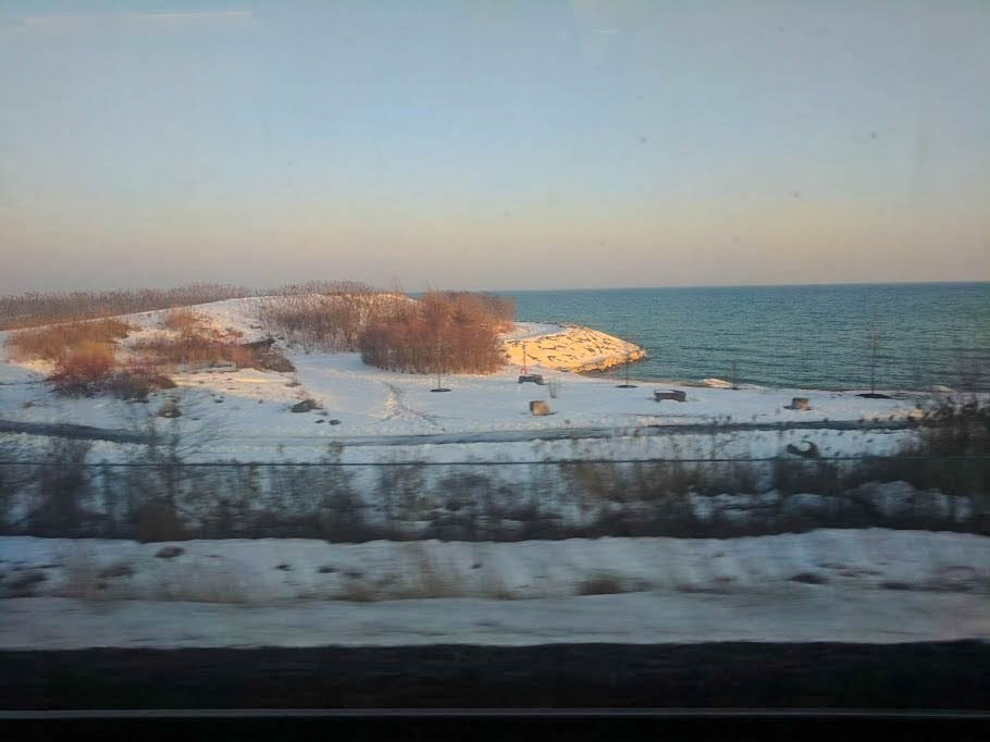The snow covered shore.