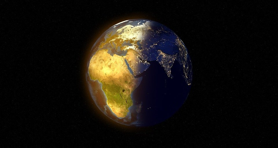 Planet earth shadowed by night and lit up by day