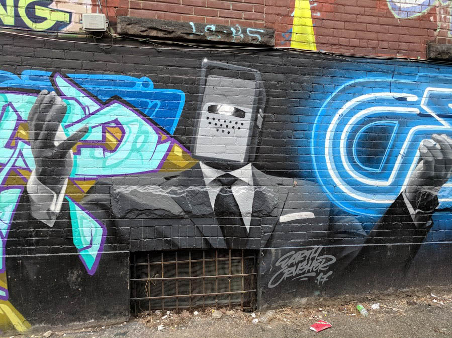 Earth Crusher street art of robot in a suit