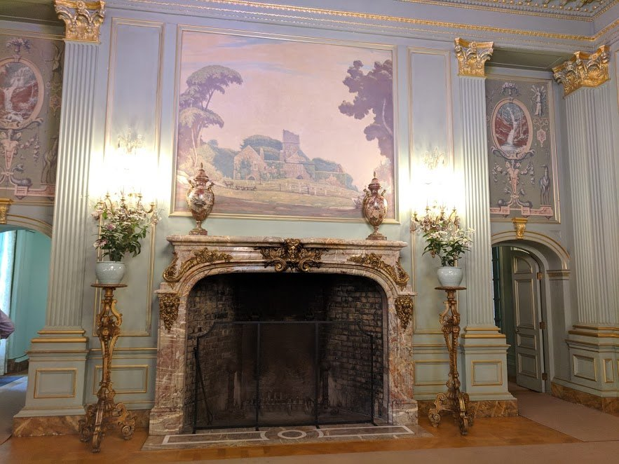 Filoli Ballroom features murals and a huge fireplace