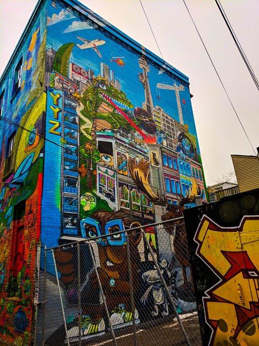 Toronto street art by Uber5000 depicting Toronto Life
