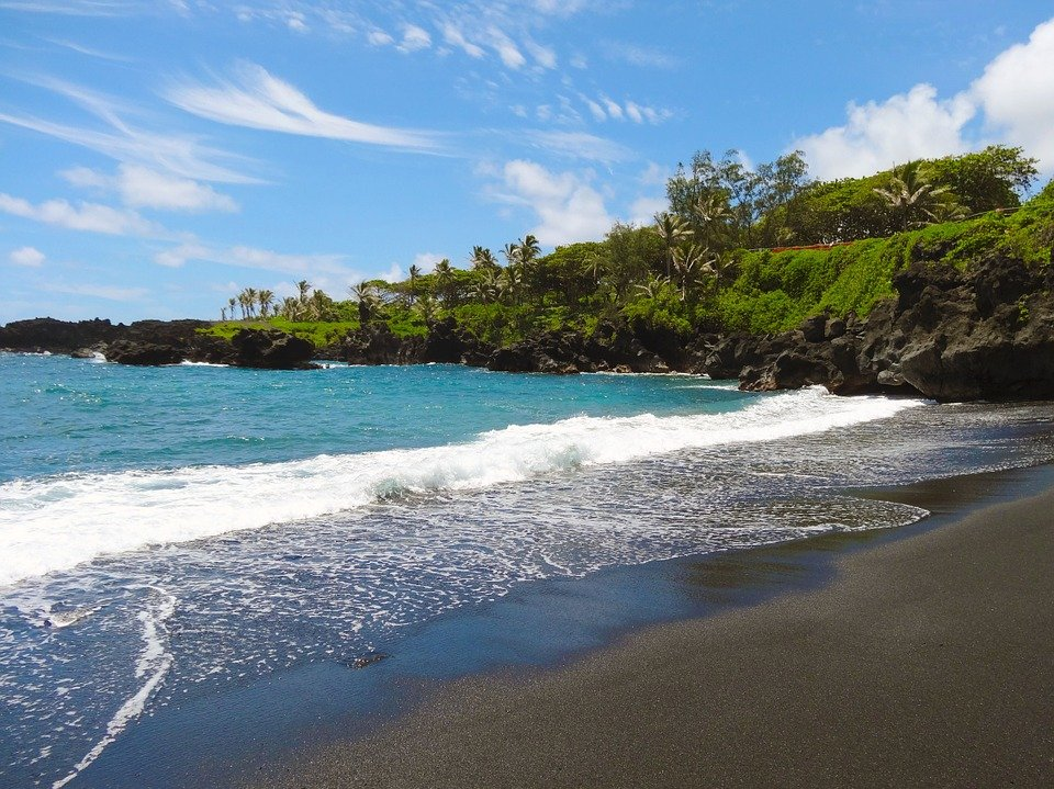 Visit a Black Sand Beach along the Road to Hana in Maui