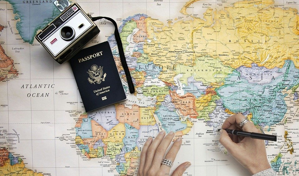 Passport, world map and camera
