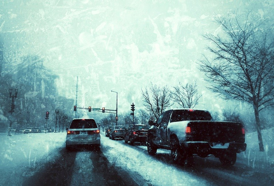 Cars driving through snowy weather