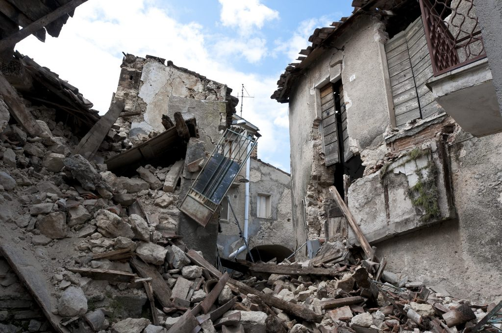 Earthquake damaged buildings and rubble