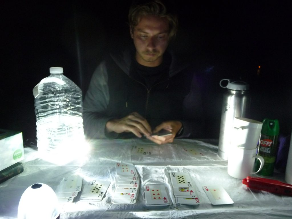 Playing cards at campsite