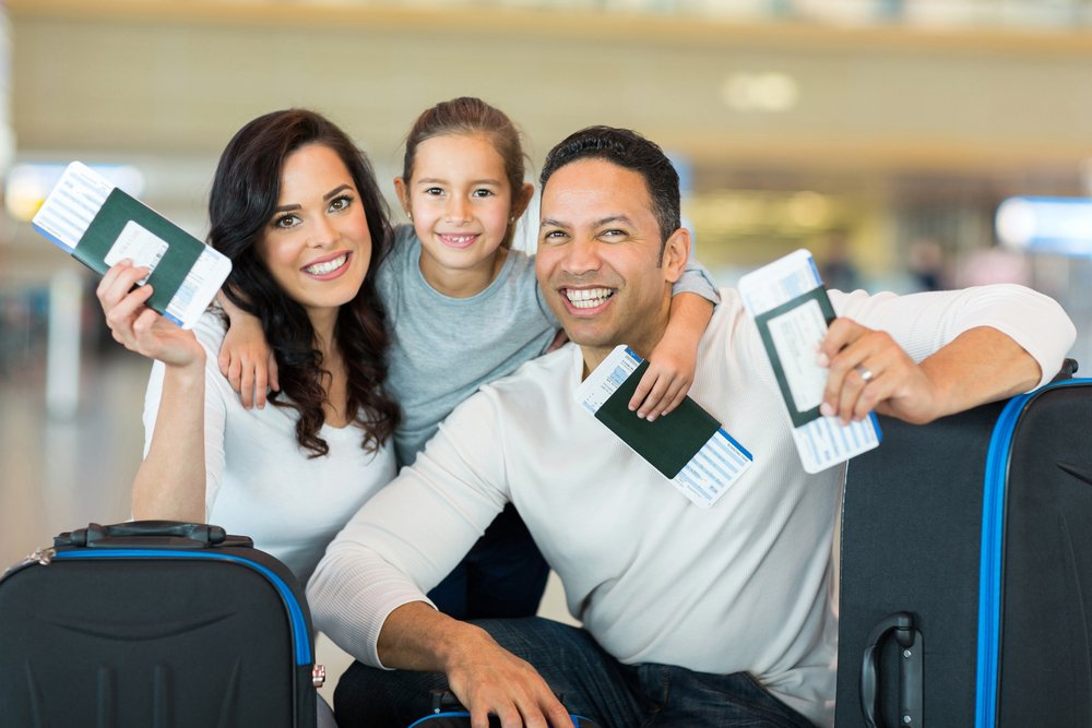 Family at airport with passports