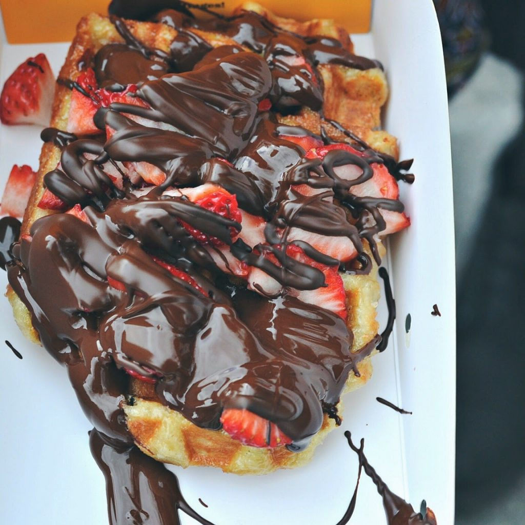 Chocolate and strawberry covered waffle