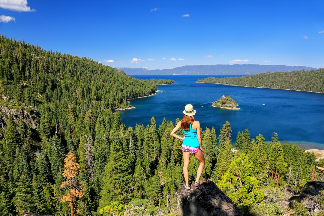 woman standing on rock overlooking Lake Tahoe
