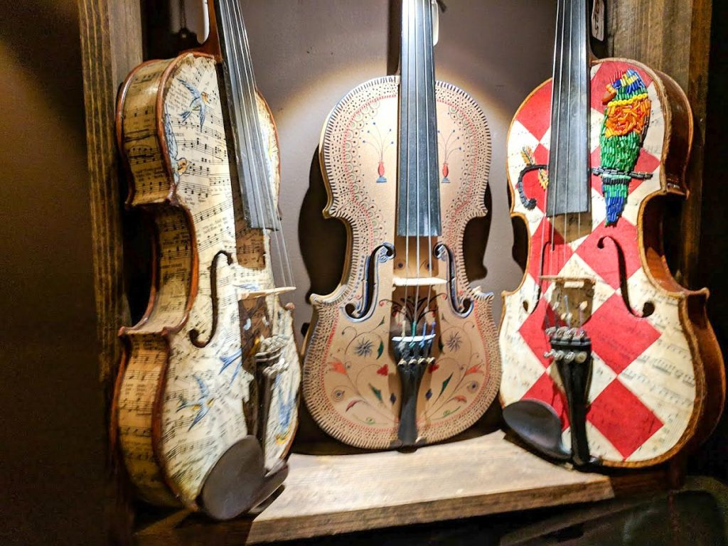Three violins, decorated with drawings