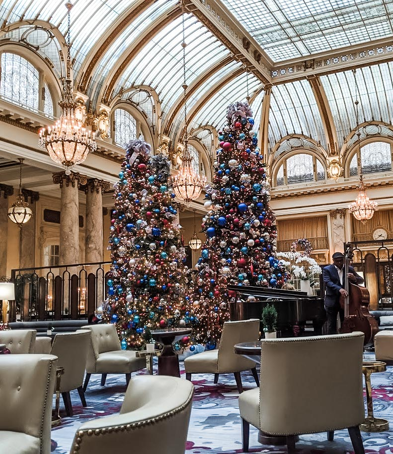 Musicians and Christmas trees inside San Francisco's Palace hotel