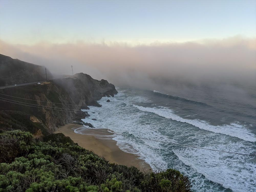 Beach and Pacific Ocean blanketed in fog