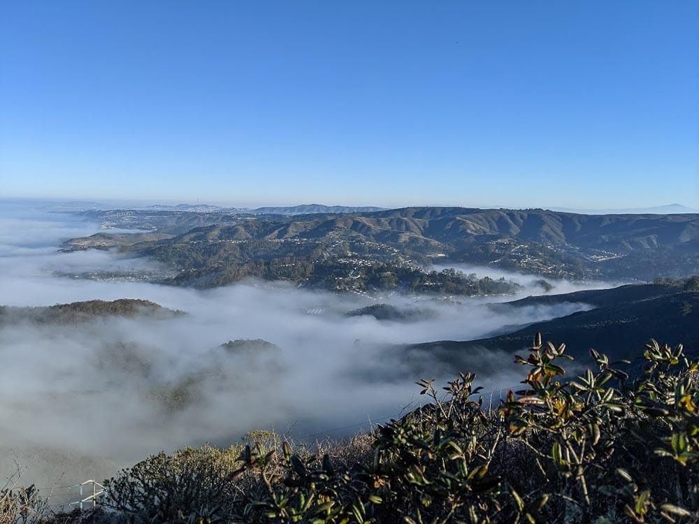 Fog covering green hillsides
