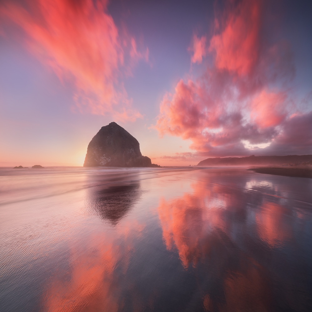 Boulder on Canon Beach in Oregon with pink clouds