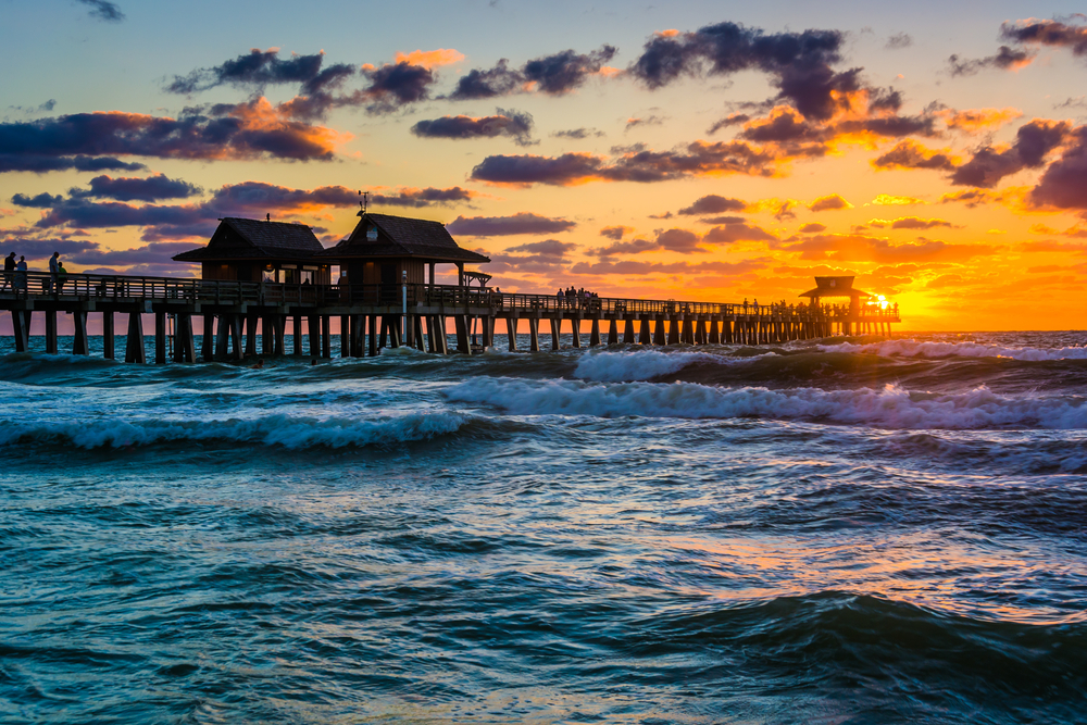Sunset over a pier with fishing shacks